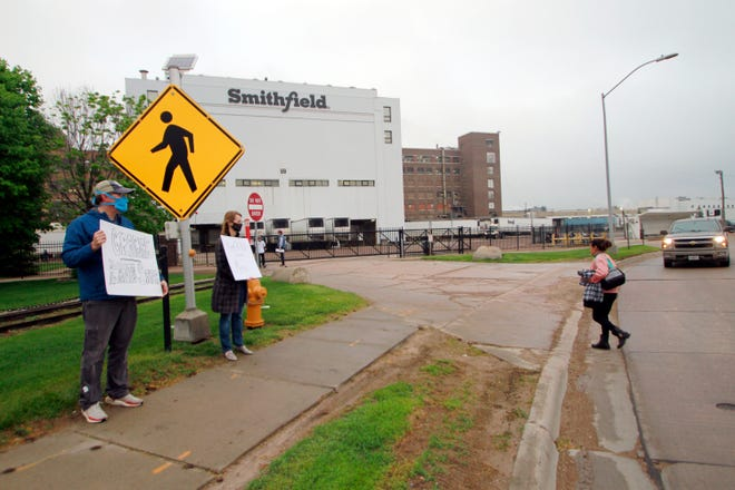 Federal regulators said Thursday, Sept. 10, 2020, they have cited Smithfield Foods for failing to protect employees from exposure to the coronavirus at the company's Sioux Falls plant, an early hot spot for virus infections that hobbled American meatpacking plants.