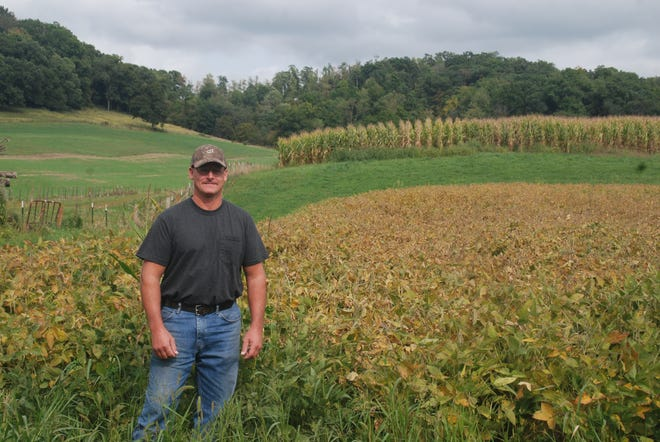 Because much of his land is steeply sloped and because a stream -- part of the Honey Creek Watershed -- runs through the farm, Roger Bindl takes care to farm with no-till practices, contour strips and cover crops.