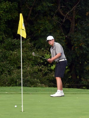 Tri-Valley's Jaret Talbot hits a putt on the sixth green in a trimatch with Coshocton and Dover on Monday at The Virtues.
