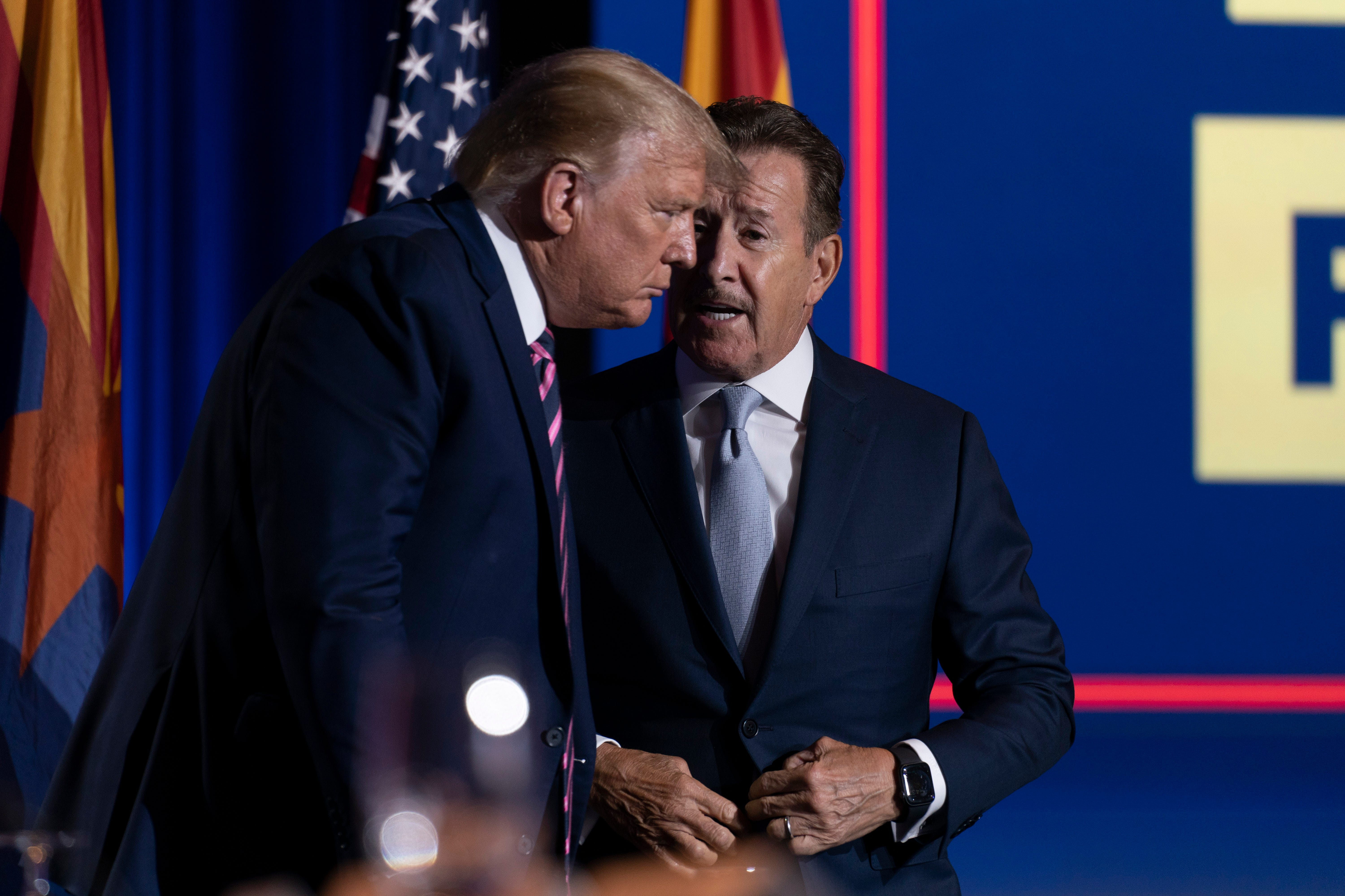 """Donald Trump speaks with Arte Moreno at a """"Latinos for Trump"""" event on Monday in Phoenix."""