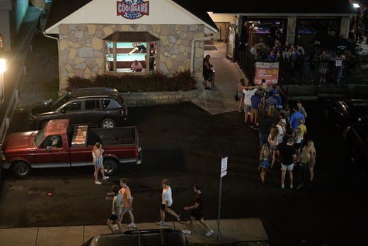 People wait in line to enter Cool Beans on The Strip on Cumberland Avenue at 11:15 p.m. Saturday in Knoxville, Tennessee on Sept. 12, 2020. The University of Tennessee is asking students to follow COVID-19 safety measures, and Knox County bars are under order to stop serving alcohol at 10 p.m.
