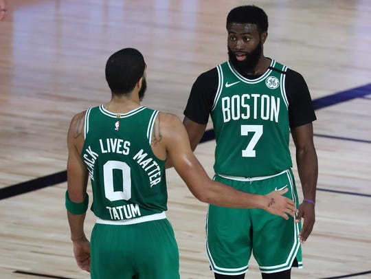 Jayson Tatum (0) and Jaylen Brown (7) have the Celtics in the Eastern Conference finals for the third time in four years.