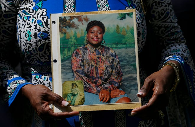 In this May 16, 2019 file photo, Antoinette Dorsey-James holds a picture of her sister Pamela Turner during a news conference outside the Harris County Civil Court in Houston. Baytown Police Officer Juan Delacruz has been charged with assault for fatally shooting Turner in the parking lot of an apartment complex where they both lived in May 2019 prosecutors announced Monday, Sept. 14, 2020. (Godofredo A Vasquez/Houston Chronicle via AP File) ORG XMIT: TXHOU403
