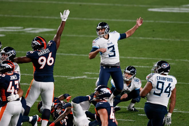 Tennessee Titans kicker Stephen Gostkowski (3) and punter Brett Kern (6) watch as the field goal attempt is deflected by Denver Broncos defensive end Shelby Harris.