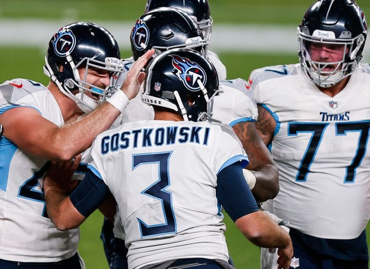 Stephen Gostkowski is congratulated by teammates after kicking the go-ahead field goal in the final seconds of the Titans' win over the Broncos.