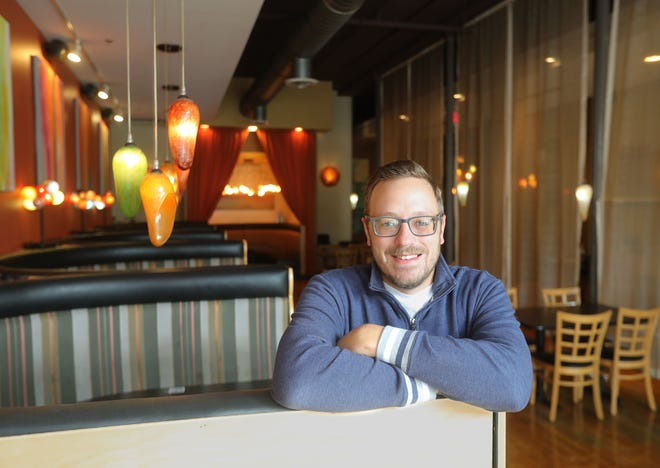 Crave general manager Jeff Kucko has started a GoFundMe page and hopes to raise $15,000 for the downtown restaurant. [Phil Masturzo/Beacon Journal]