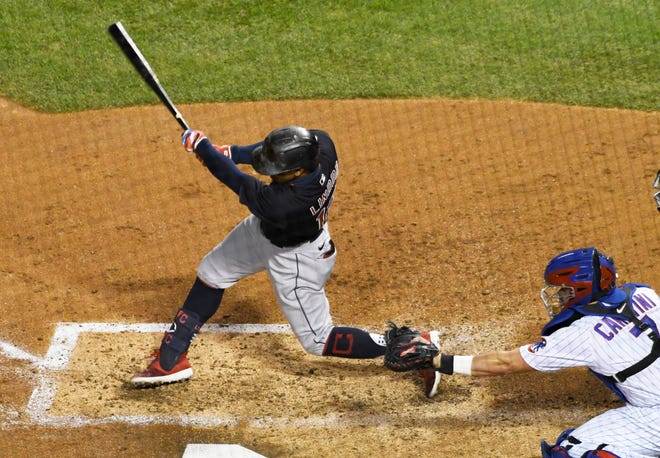 Cleveland Indians' Francisco Lindor (12) hits a one-run double against the Chicago Cubs during the third inning of a baseball game, Tuesday, Sept.15, 2020, in Chicago. (AP Photo/David Banks)