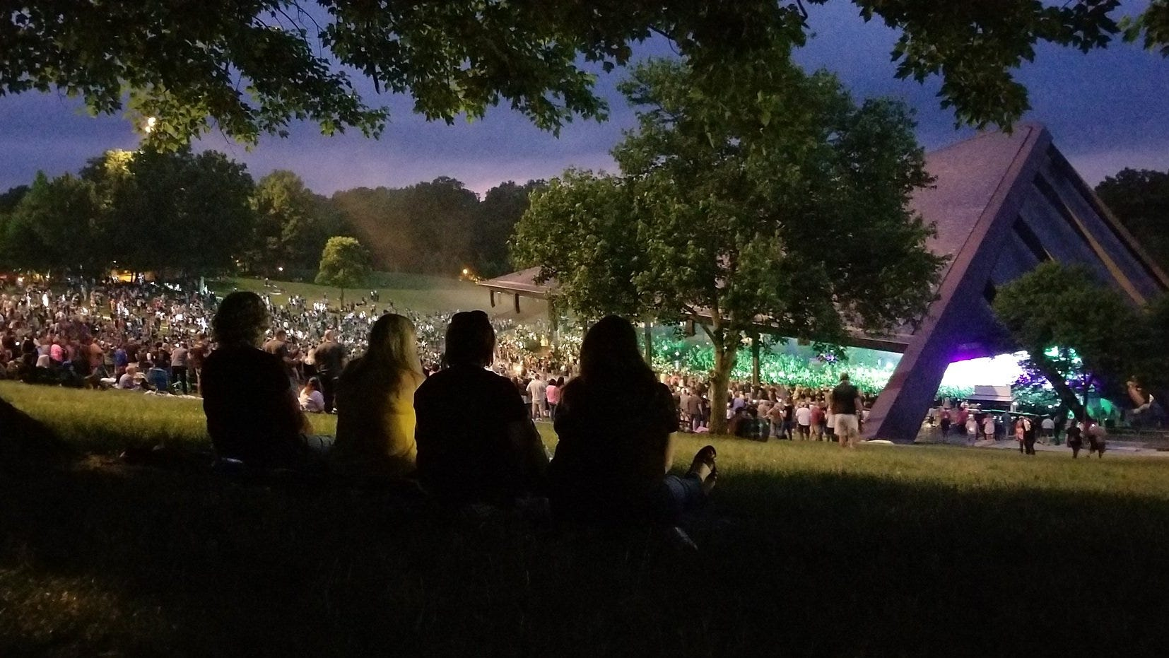 Concert goers listen to the rock band Poison at Blossom Music Center on Tuesday June 13, 2018 in Cuyahoga Falls, Ohio. [Mike Cardew/Beacon Journal File]