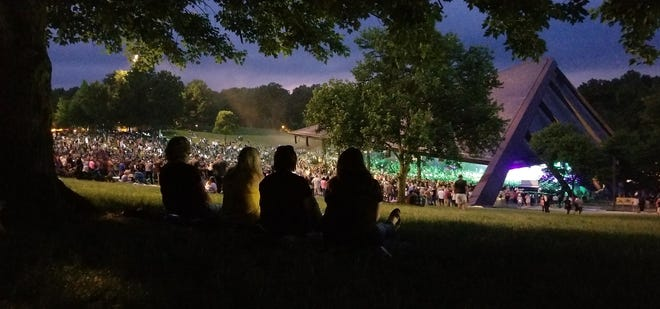 Concertgoers listen to the rock band Poison in June 2018 at Blossom Music Center in Cuyahoga Falls.