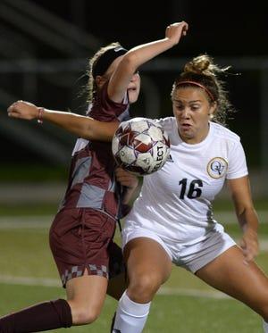 Beaver's Abby Noah battles with Quaker Valley's Juliana Helkowski Tuesday night at Pat Tarquinio Stadium.