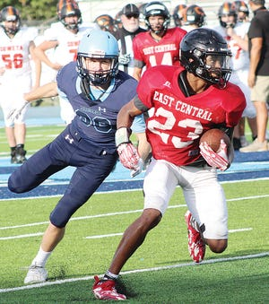 A Bartlesville High School defender, left, begins to run down an East Central ballcarrier during varsity football scrimmage action last month.