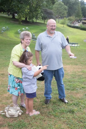 Valley Hospice volunteer Dottie Folmar and her family release butterflies at last year's event.
