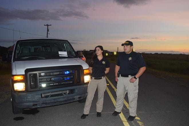 At Four Point Road Deputies Heather Guidroz and Adam Billiot start their 12-hour shift.