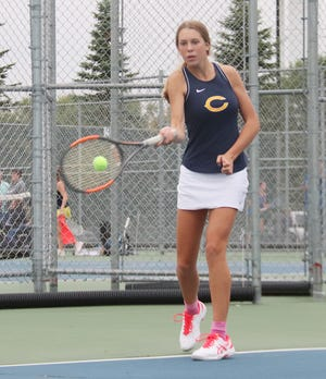 Abby Borowicz in a match Tuesday against Thief River Falls. Borowicz won her match at No. 4 singles on Wednesday against East Grand Forks.