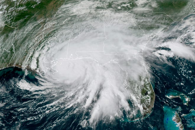 This GOES-16 GeoColor satellite image taken Tuesday, Sept. 15, 2020, at 3 p.m. EDT., and provided by NOAA, shows Hurricane Sally moving slowly towards the coast from the Gulf of Mexico. Forecasters now expect landfall late Tuesday or early Wednesday near the Alabama-Mississippi state line. (NOAA via AP)