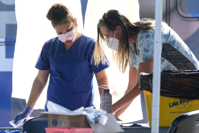 Health care workers conduct COVID-19 testing at Lake-Sumter State College in Leesburg. [Cindy Peterson/Correspondent]