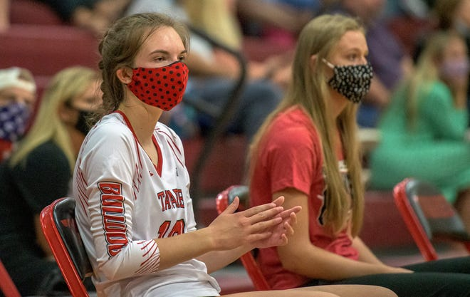 Tavares' Danica Metcalf (10) wears a mask on the sidelines during Tuesday's match Eustis in Tavares. [PAUL RYAN / CORRESPONDENT]