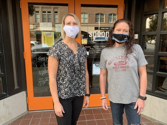 From left to right, Wendy Topp, a Kiwanis Club of Wooster member and manager of Murr Printing and Graphics, and Jordan Smith, co-owner of Spoon Market & Deli, stand outside the restaurant on Wednesday morning.