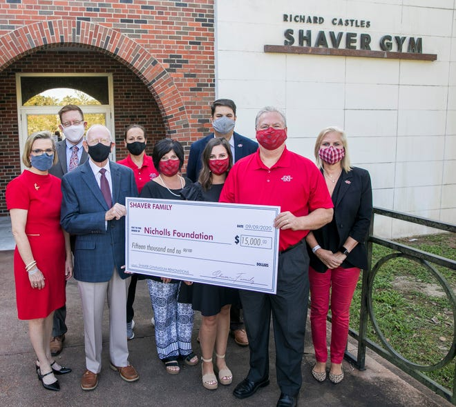 Members of the Shaver family and representatives of Nicholls State University mark the donation.