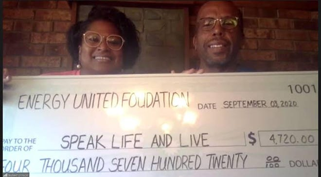 Leslie and Fredrick Morrison accepted the $4,720 donation from the EnergyUnited Foundation to Speak Life and Live.