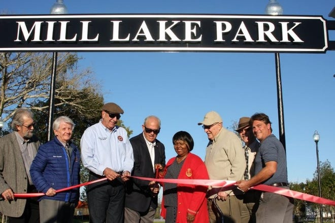 Orange City officials celebrate the opening of Mill Lake Park with a ribbon cutting on Jan. 7 2015.