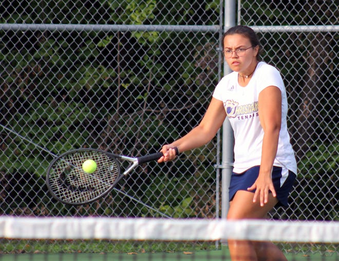 William Chrisman's Mackenzie Alfrey hits a forehand return in her No. 4 singles match against Truman's Kaleigh Harger Tuesday at Santa Fe Trail Park. Alfrey won 8-0 to help the Bears to a 9-0 victory.