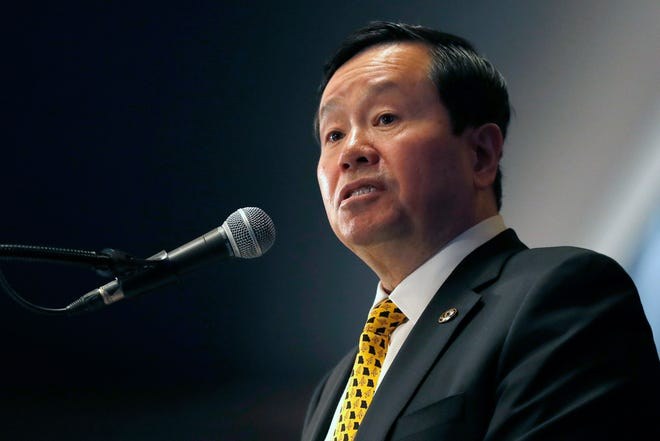 University of Missouri system president Mun Choi speaks during a December news conference in Columbia. Mizzoui Journalism School faculty members are criticizing the university system's president for comments and actions that they say could discourage dissent. Fifteen faculty members signed a letter Monday to Choi, who is also chancellor at system's flagship Columbia campus.