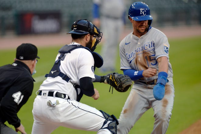 Kansas City Royals runner Whit Merrifield (15) is tagged out by Detroit Tigers catcher Austin Romine as he tries to score in the first inning of Tuesday's game in Detroit. The Royals failed to score after Merrifield's leadoff double and were blanked 6-0 by the Tigers.