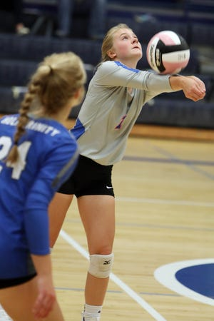 Holy Trinity High school'sMaria Rauenbuehler (1) returns the ball during their match against Notre Dame High School,Tuesday Sept. 15, 2020 at Notre Dame's Father Minett gymnasium.