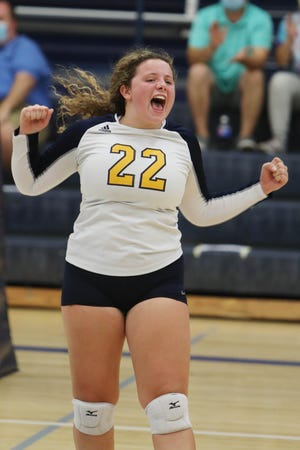 Notre Dame High school's Maisey Belger (22) celebrates a point during their match against Holy Trinity High School Tuesday at Notre Dame's Father Minett gymnasium.
