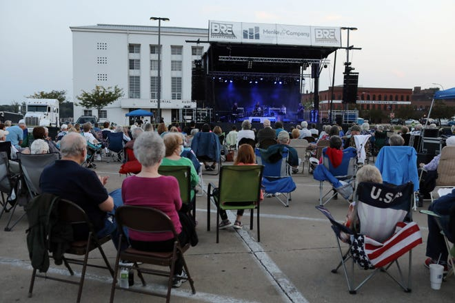 Concertgoers enjoy the music of the George Maurer Quartet as Burlington Civic Music holds its opening concert in the parking lot of the Burlington Memorial Auditorium with Six Appeal and the George Maurer Quartet entertaining the audience Sept. 15, 2020, along the Mississippi riverfront.