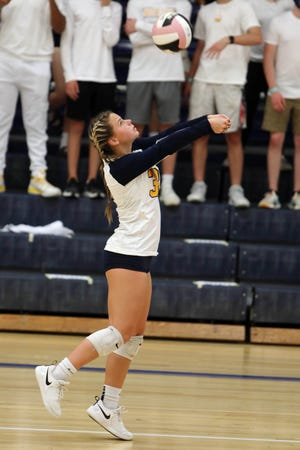 Notre Dame High school's Karli Artman (33) keeps the ball in play during their match against Holy Trinity High School,Tuesday Sept. 15, 2020 at Notre Dame's Father Minett gymnasium.