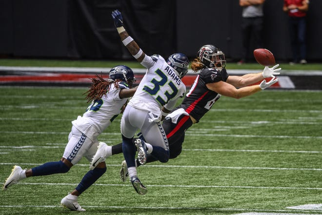Atlanta Falcons tight end Hayden Hurst, seen here catching a pass Sunday against the Seattle Seahawks, donated $3,000 to the GoFundMe account of an ABC sports reporter in Columbia, S.C. so Mike Gillespie could pay for his dog to have emergency surgery. The Bolles School product knew Gillespie from the time he covered South Carolina's football program when Hurst played there. (AP Photo/Danny Karnik)