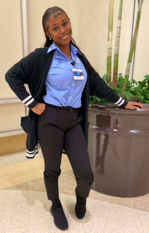 Ellissa Stokes poses at Mayo Clinic in Jacksonville, where she works as a patient service specialist. She graduated this year from the Generation Jacksonville job training program that helps people overcome obstacles to employment.