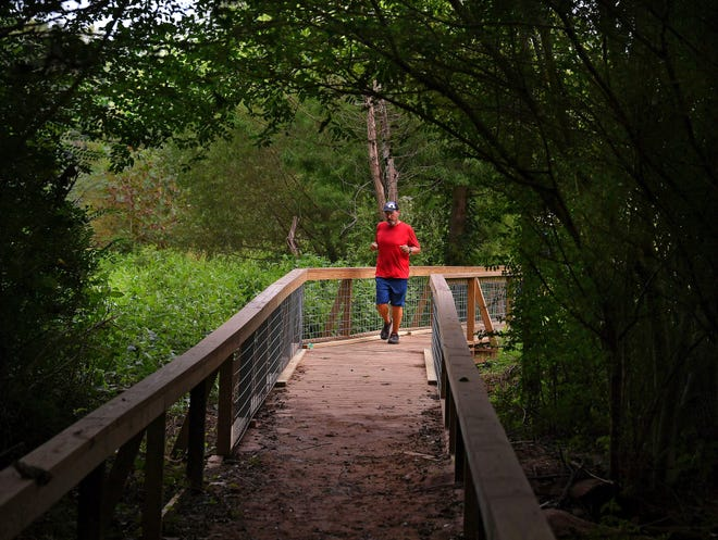 The Cottonwood Trail Boardwalk Restoration Project is almost completed, with an official reopening of the boardwalk later this month. Eric McKaig jogs along the boardwalk on the Cottonwood Trail in Spartanburg, Tuesday morning, September 15, 2020.