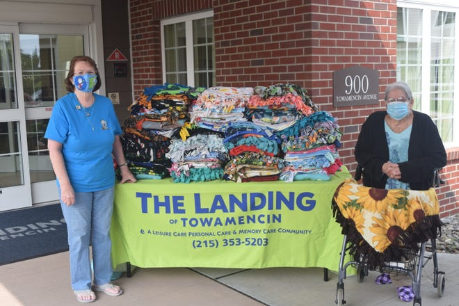Dot Walsh, right, a resident of The Landing of Towamencin, created more than 100 fleece-tied blankets to be distributed by Project Linus, an outreach organization that helps children who are in hospitals, shelters or social service agencies. Jackie Cain, left, coordinator for Project Linus of Montgomery and Bucks counties, recently visited Walsh at The Landing to pick up the blankets and thank her for the donation.