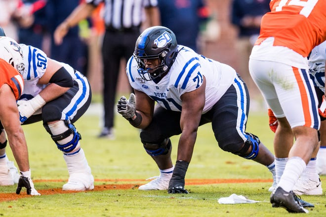 Duke offensive lineman Maurice McIntyre, a former Northside standout, lines up at the line of scrimmage during a play in a game last season. [Duke Athletics]