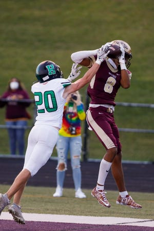 Stow-Munroe Falls senior wide receiver Dalen Stovall brings down a pass for a touchdown during the Bulldogs' 31-7 win over Medina Highland Sept. 11 at Bulldog Stadium.