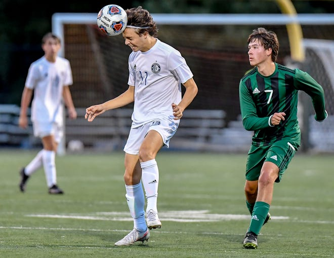 Hudson junior Mike Kane gets his head to the ball ahead of Nordonia's Sean Joyce during the Explorers' 4-0 win at Nordonia Sept. 15.