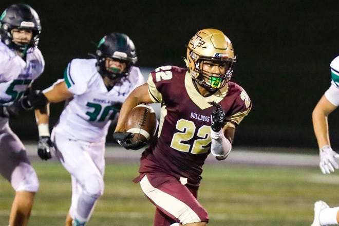 Stow-Munroe Falls senior running back DeAnthony Becton breaks free for a 33-yard touchdown run during the Bulldogs' 31-7 home win over Medina Highland Sept. 11.