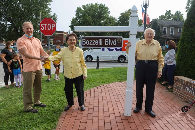 Cuyahoga Falls Mayor Don Walters is pictured with Madeline & Libert Bozzelli. A small ceremony took place on Monday with family of the Bozzellis to ceremonially rename Broad Boulevard to Bozzelli Boulevard.