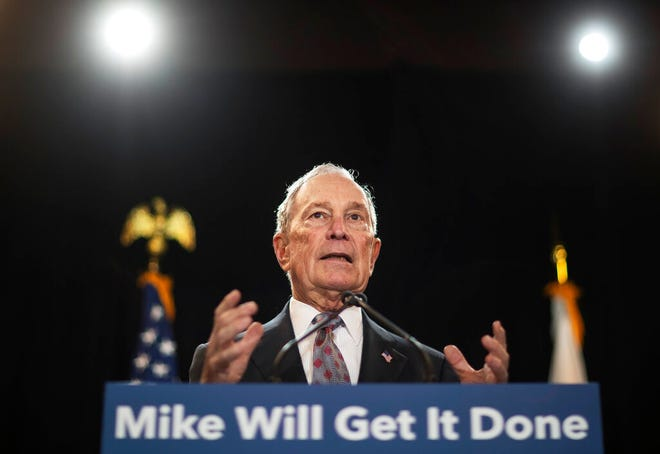 """In this Feb. 5, 2020, file photo, then-Democratic presidential candidate and former New York City Mayor Michael Bloomberg speaks at a campaign event in Providence, R.I. Bloomberg has come through on his vow to spend """"whatever it takes"""" to defeat President Donald Trump. The former presidential candidate has pledged to spend $100 million in Florida to boost Joe Biden there."""