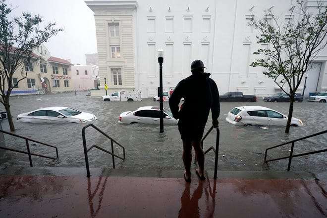 Flood waters move on the street Wednesday in downtown Pensacola. Hurricane Sally made landfall Wednesday near Gulf Shores, Alabama, as a Category 2 storm, pushing a surge of ocean water onto the coast and dumping torrential rain that forecasters said would cause dangerous flooding from the Florida Panhandle to Mississippi and well inland in the days ahead.
