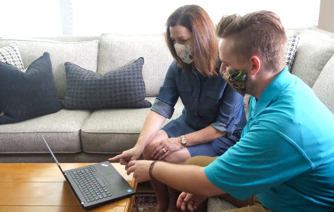 Marc Storch, a trainer with GroovyTek, works with Kim Pemberton, a client, in Denver. The company helps older people understand consumer technology. It serves South Florida customers from Jupiter to Fort Lauderdale from its Boca Raton office.