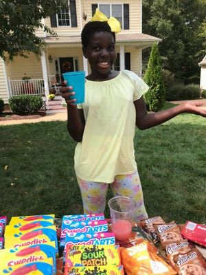 Lucy Hansen raised money for Swift Creek Mill Theatre's repairs with her business savvy and a lemonade and snack stand.