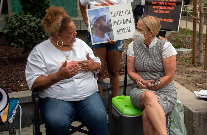 Stephanie Hatten, left, whose son Antwane Burrise was shot and killed by Stockton police on July 15, talks with San Joaquin County District Attorney Tori Verner Salazar during a protest over Burrise's killing on Sept. 10.