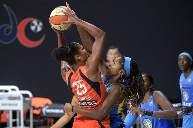 Connecticut Sun forward Alyssa Thomas, left, is fouled by Chicago Sky forward Ruthy Hebard, right, while going up for a shot during the second half of a WNBA basketball first-round playoff game, Tuesday, Sept. 15, 2020, in Bradenton, Fla. (AP Photo/Phelan M. Ebenhack)