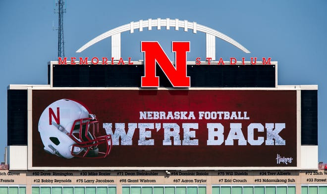 Memorial Stadium's north stadium video board projects the news of the return of Big Ten NCAA college football, Wednesday in Lincoln, Neb. The Big Ten conference changed course Wednesday and said it plans to open its football season the weekend of Oct. 23-24.