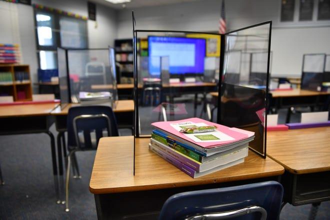 Tri-fold plexiglass shields await students' return in late August at Ashton Elementary School.