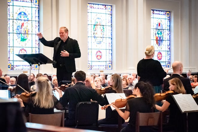 Artistic Director Joseph Caulkins leads a performance of the Key Chorale. The group launches its 36th season this month.